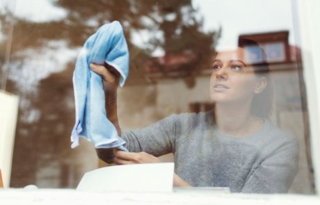 214710-2121x1414-woman-cleaning-glass-of-window