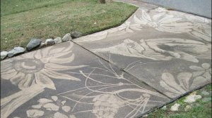 Artwork on concrete pathway created with a power washer